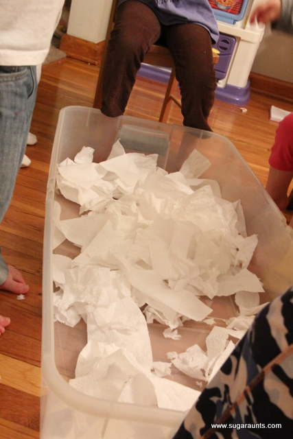 How to make fake snow using toilet paper for a fun sensory challenge to the hands.