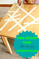 Kids can work on fine motor skills by playing with masking tape on a table surface.