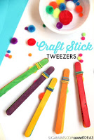 Fine motor play activity using tweezers made from craft sticks