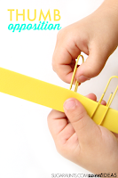 Work on fine motor skills with paperclips to improve thumb opposition.