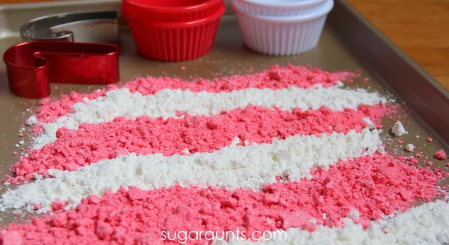 Moon dough recipe that kids can make for a Christmas sensory activity. Make this candy cane scented sensory dough with kids.