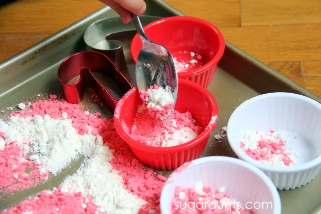 Moon dough activity for kids to scoop and pour for a holiday sensory activity.