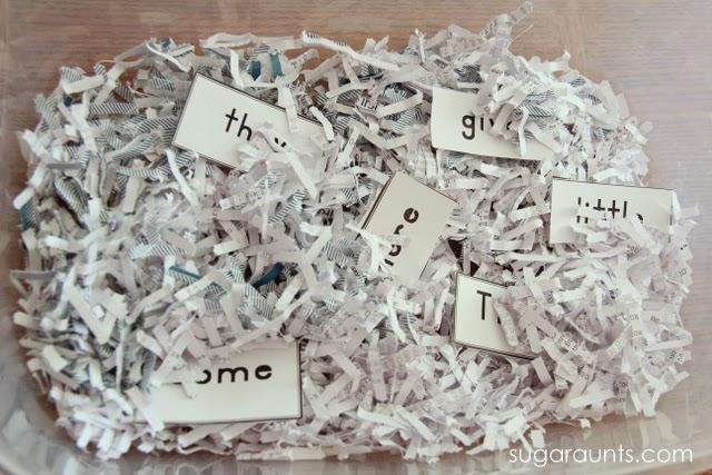 Kindergarten sight words in a sensory bin with shredded paper.