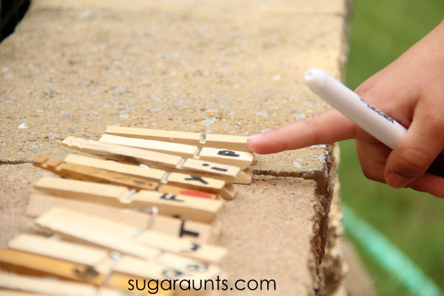Learning and play with clothes pins in literacy activity. from Sugar Aunts.