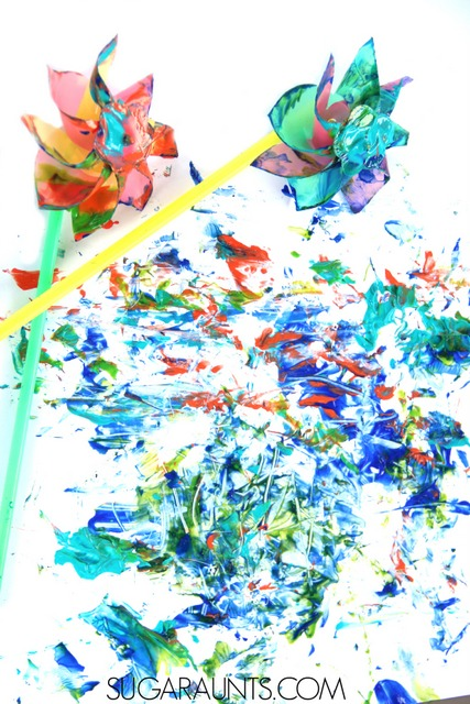 Painting with Pinwheels Art activity for sensory painting.