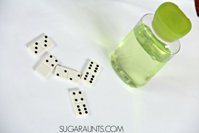 Make a math inspired dominoes sensory or discovery bottle with light! this is perfect for Kindergarten and First grade math.