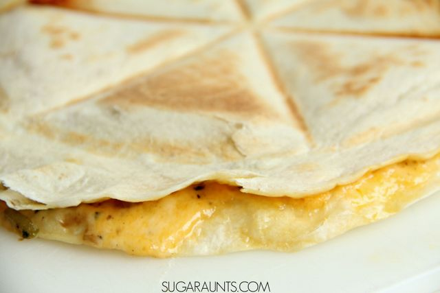 Vegetable Quesadilla Recipe with mushrooms, peppers, onions, and two kinds of cheese, a great dish for kids to eat and make in the kitchen.  Cooking with kids is a great learning opportunity in so many areas!