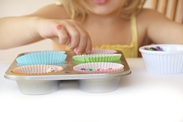 Scooping, pouring, transferring beads and developing fine motor skills and hand dominance in Toddlers, Preschoolers, and school-aged kids. Plus learning ideas to use in scooping activities.  From an Occupational Therapist.