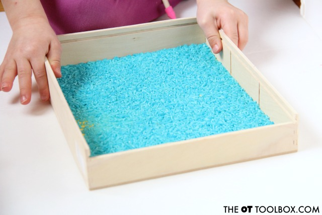 Kids can use an easy rice writing tray to work on bilateral coordination as well as letter and number formation.