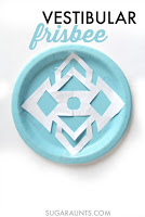 Super easy and fun Frisbee Vestibular activity for indoor play this winter.  Get the kids moving!