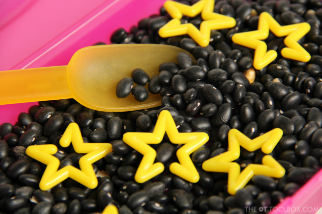 Use star chain links to work on therapy goals like fine motor skills and sensory needs with a mini star sensory bin.